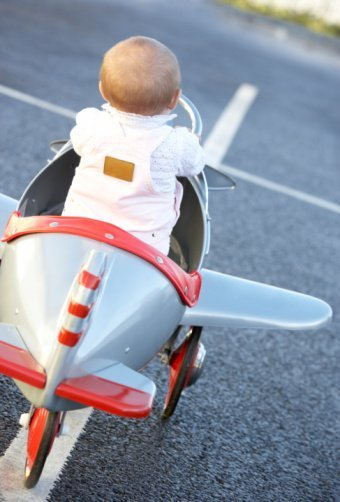 Baby Girl Riding In Toy Aeroplane