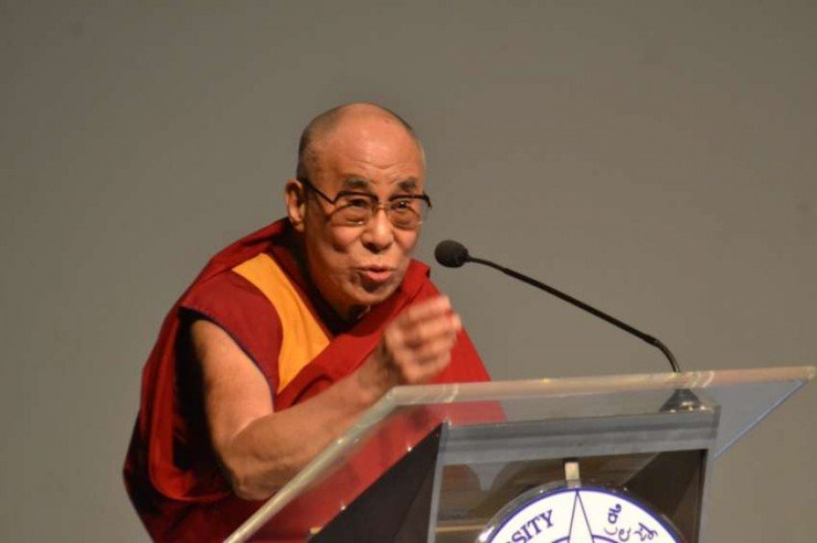 Tibetan spiritual leader Dalai Lama delivers his lecture on `Bounds of Ethics in a Globalized World` at Christ University in Bangalore on Jan.6, 2014. (Photo: IANS)