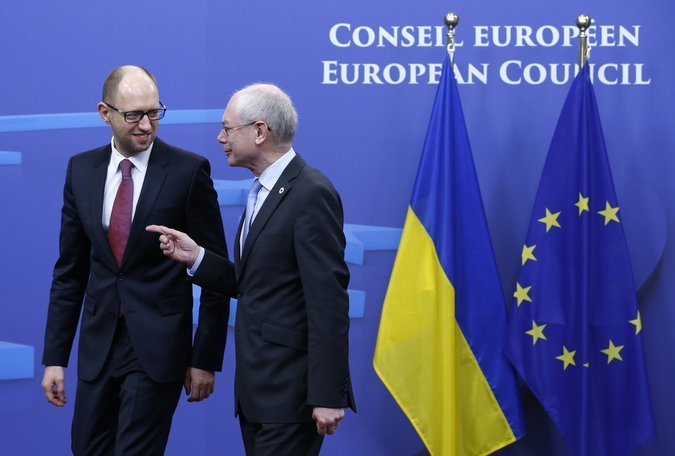 Ukraine's Prime Minister Yatsenyuk is welcomed by European Council President Van Rompuy ahead of a European leaders emergency summit in Brussels