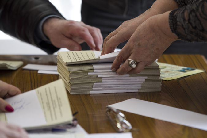 Election commission officials count ballots as they take part in preparations for a referendum inside a school in Sevastopol
