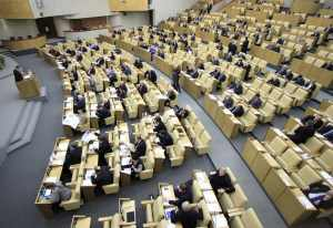 Russia's deputies discuss a nuclear arms reduction pact before the final vote during a session of the lower house of parliament, the State Duma, in Moscow