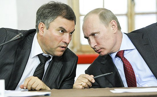 Russia's Prime Minister Putin talks to Government Chief of Staff Volodin during a meeting on the development of local self-government in Pskov's Kremlin