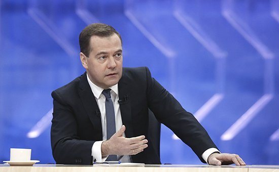 Russian Prime Minister Dmitry Medvedev speaks during a televised interview with Russian media in Moscow