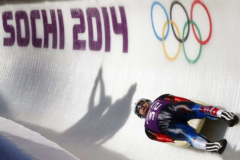 Russia's Demchenko speeds down the ice track during the men's luge training at the Sanki sliding center in Rosa Khutor, a venue for the Sochi 2014 Winter Olympics near Sochi