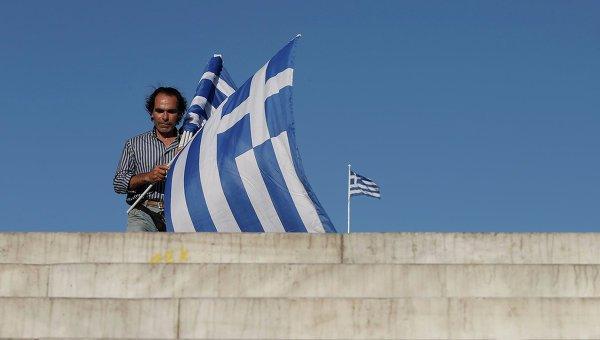 © AP Photo/ Petros Giannakouris
