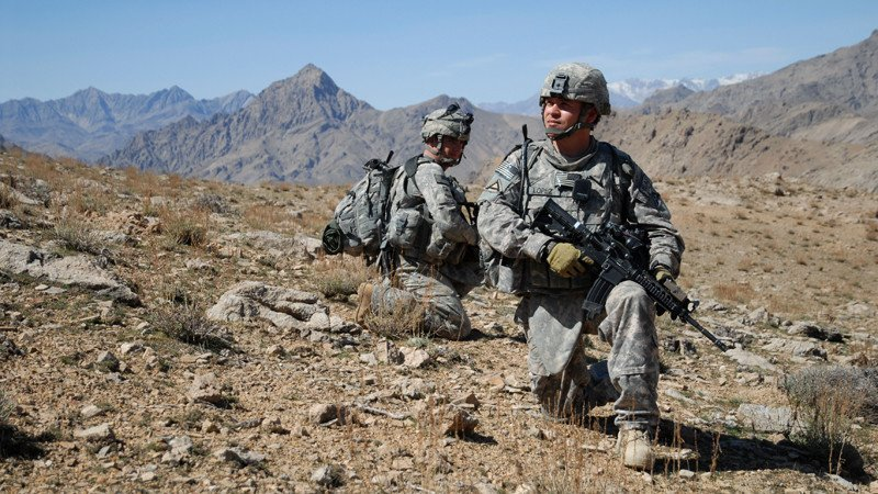 090308-A-6797M-435        U.S. Army Staff Sgt. Salvador Lopez (right) and Spc. Ashley Shaw, both assigned to 1st Battalion, 4th Infantry Regiment, U.S. Army Europe, take a knee while descending a mountain ridge near Forward Operation Base Lane in Zabul province, Afghanistan, on March 8, 2009.  DoD photo by Staff Sgt. Adam Mancini, U.S. Army.  (Released)