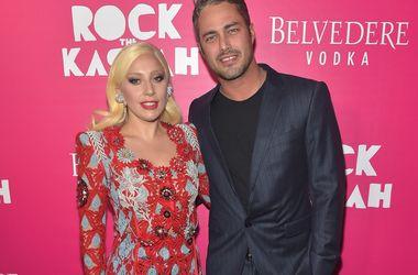 Леди Гага и Тейлор Кинни. Фото: AFP