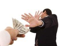 Коррупция замедляет экономическое развитие общества и подрывает государственные устои (Фото: Helder Almeida, Shutterstock)