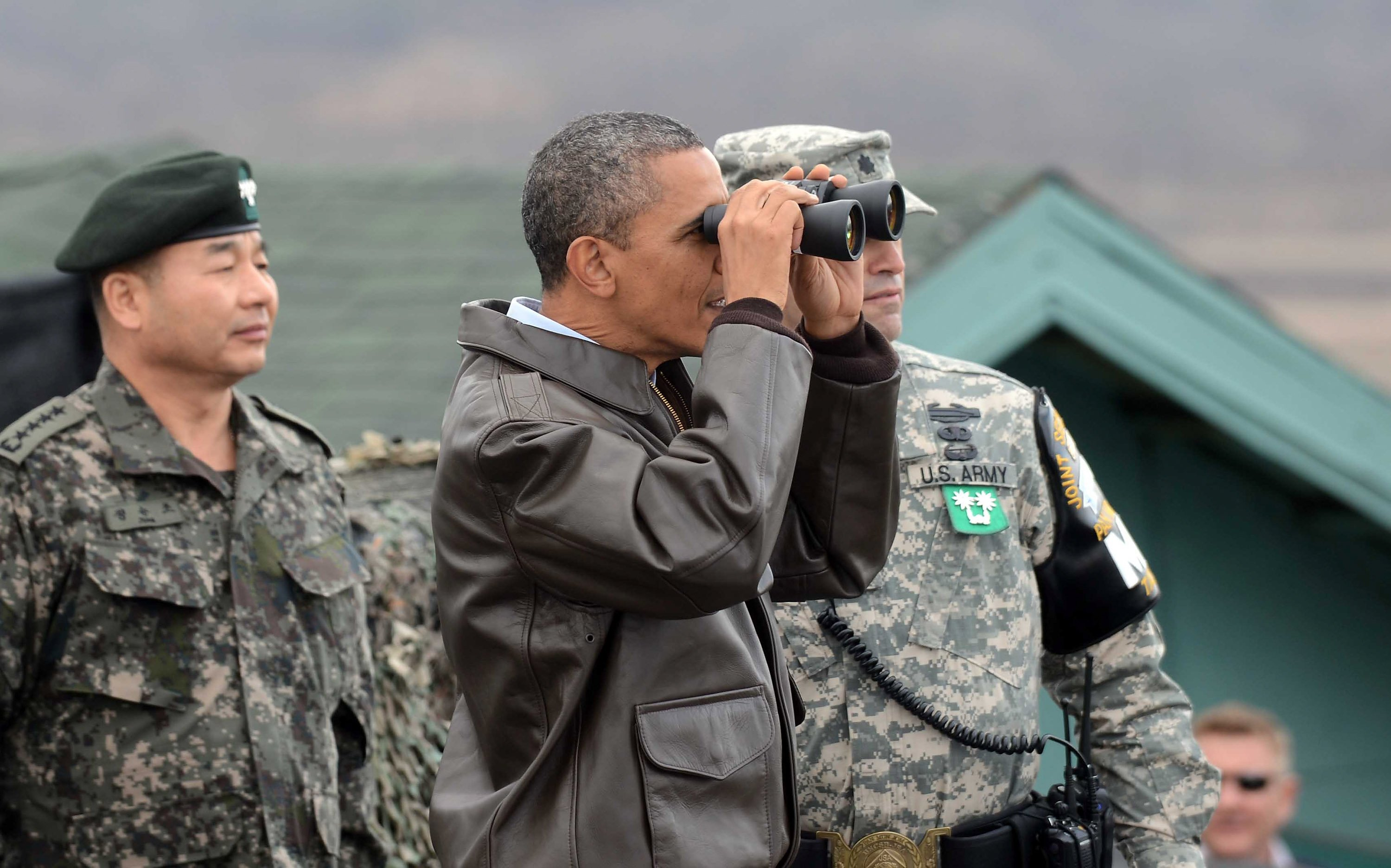PANMUNJOM, SOUTH KOREA - MARCH 25: U.S. President Barack Obama uses binoculars to look at North Korea from the Observation Post Ouellette in the Demilitarized Zone which separates the two Koreas in the inter-Korean truce village of Panmunjom on March 25, 2012 in Panmunjom, South Korea. World leaders gather at Seoul to discuss on the issues to prevent possible nuclear terrorism and recurrence of meltdown of nuclear power plants and to minimize nuclear material across the world. (Photo by Yonhap News via /Getty Images)