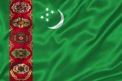 Флаг Туркменистана (Фото: Yuriy Boyko, Shutterstock)