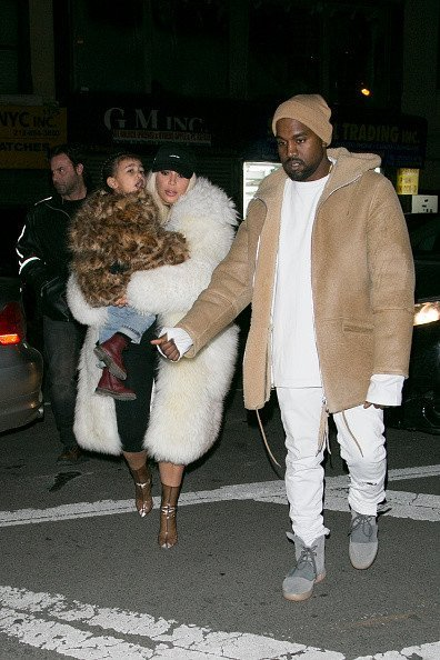 Ким с мужем Канье Уэстом и дочкой Норт, Фото: Getty Images